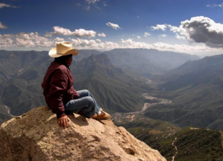 Man overlooking canyon